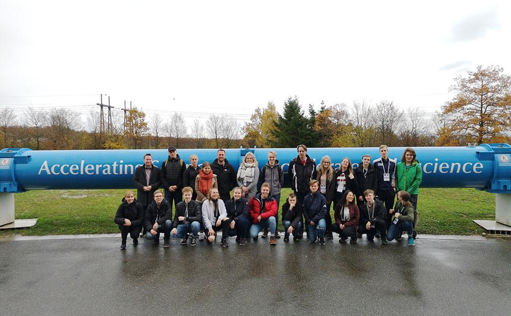 group of students attending the science research center near the CERN main gate